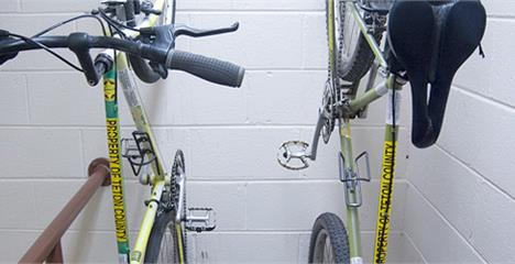 Close up of 2 bikes hanging on a wall