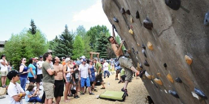 Man at Bouldering Event Climbing Wall